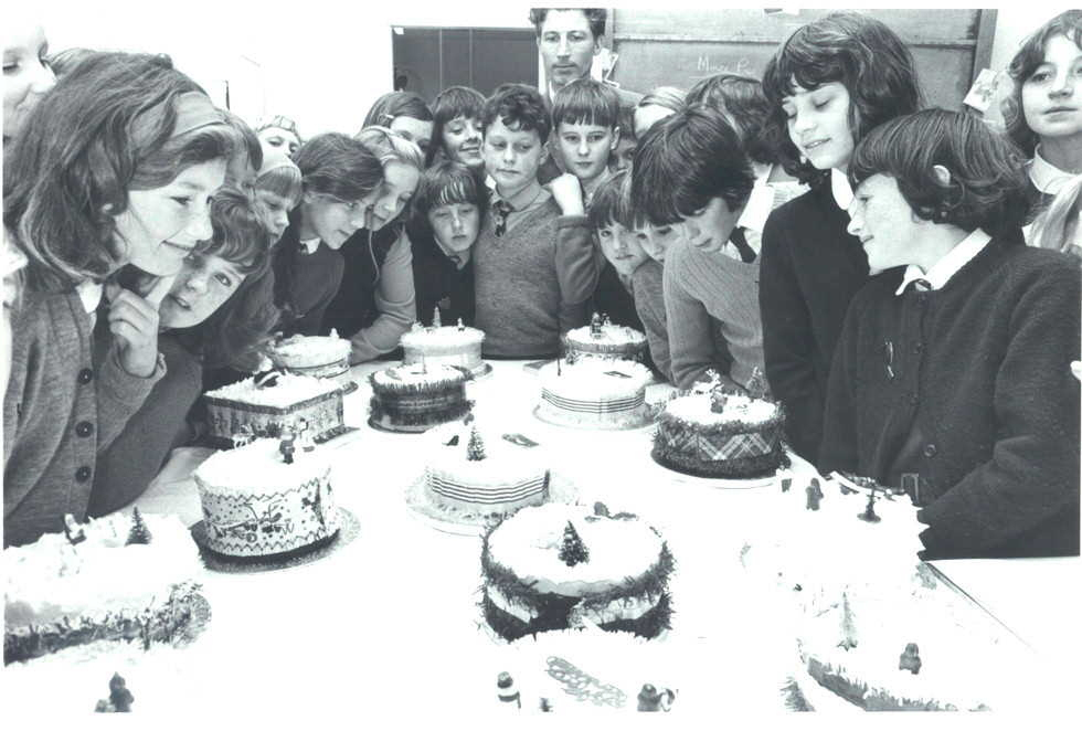 Admiring the Christmas cakes: children from Geason's Lane Primary School, Plymouth, in 1971